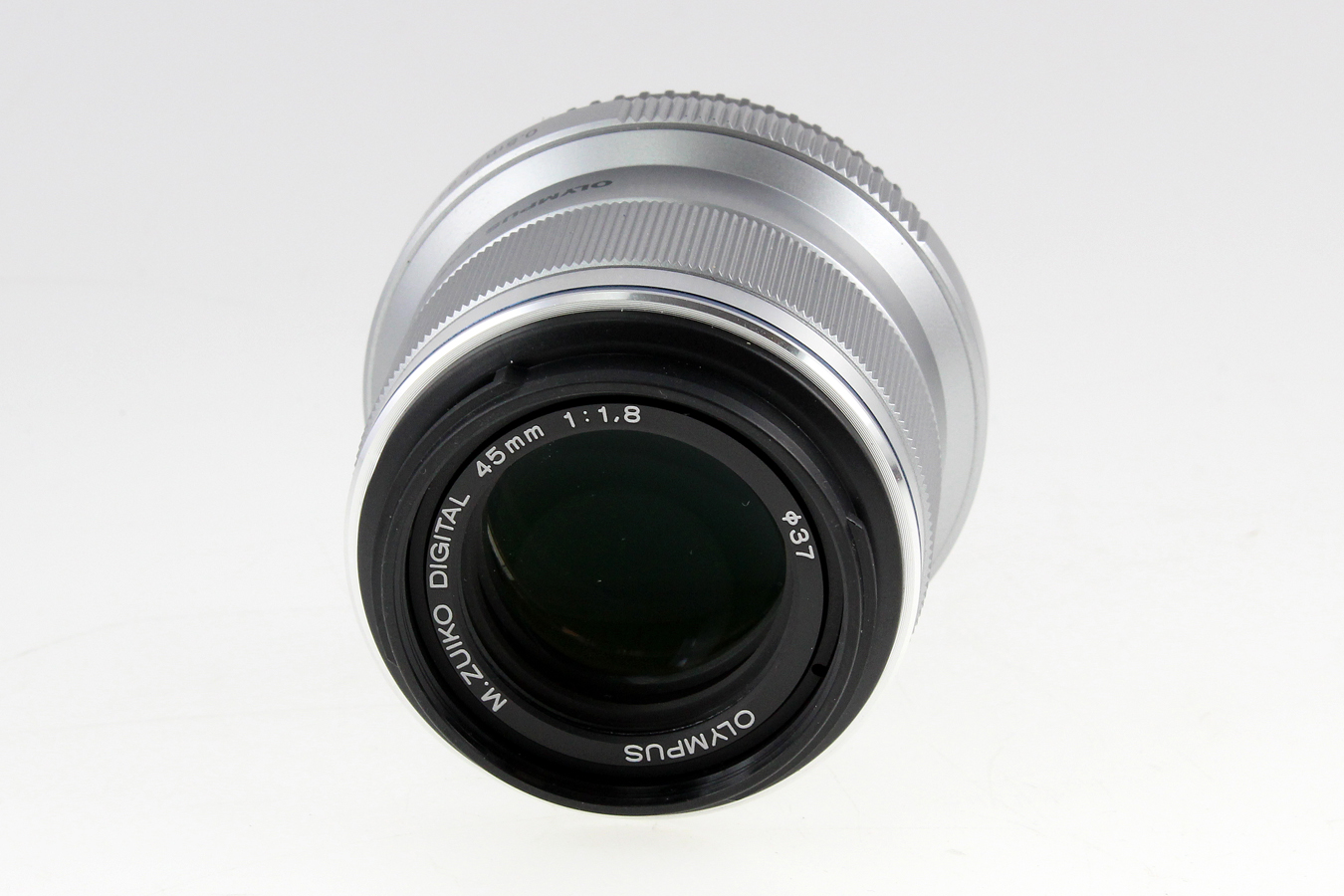 Preowned camera equipment olympus m 45mm f18 silver baditri Images